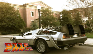 The BTTF car DeLorean Time Machine Hire in front of The Clock Tower at Universal Studios Hollywood